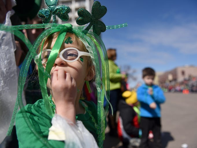 Kennedy Weisser watches the 38th annual St. Patrick's