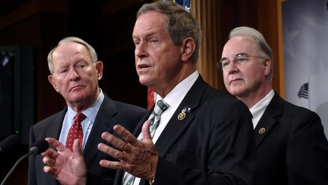 """In a 2015 file photo, Rep. Joe Wilson, R-S.C., center, speaks during a news conference on Capitol Hill. Wilson is the congressman who shouted """"You lie"""" at President Barack Obama during a joint session of Congress in February 2009."""