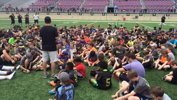Campers listen in as Jacob Hester teaches them about life and football at his eighth annual camp Saturday at Independence Stadium.