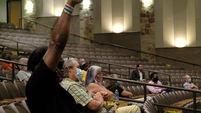 An audience member supports the statements of Pastor Bernie Jackson during the Bastrop City Council meeting at the Performing Art Center on the removal of the confederate monument at the Bastrop County courthouse July 7, 2020. NELL CARROLL/AMERICAN-STATESMAN