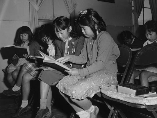 Children read at a Sunday school class at the Manzanar Relocation Center in 1943. More than 110,000 Japanese-Americans were relocated from the West Coast to camps like Manzanar during World War II, even though no U.S. citizen of Japanese ancestry ever was accused of sabotage or treason in connection with the war.