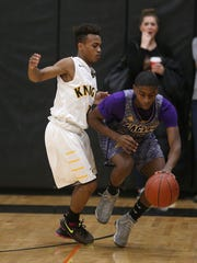 East's Chaz Washington (right) is pressured by McQuaid's