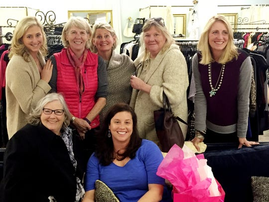 """The shopping """"party"""" included Jean Reid and Amy Bush, seated; and standing, from left, Kate Surmeier, Mary Hance, Amy Kauerz, Tish Demster and Carson Reid during a break from shopping at The Private Label."""