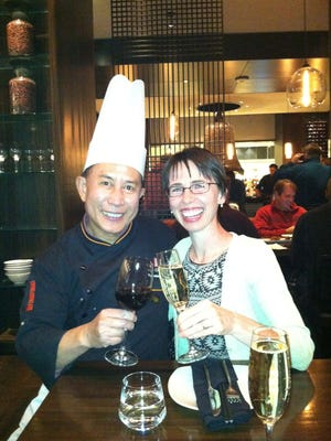 Martin Yan celebrates with a guest at M.Y. China.