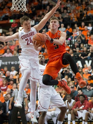 Oregon State forward Tres Tinkle drives to the basket during the Beavers' 69-49 win over Washington State at Gill Coliseum on Feb. 28, 2016