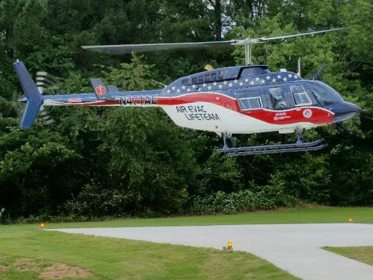 An Air Evac Lifeteam helicopter approaches the helipad.
