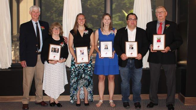 "The Pacelli Athletic Hall of Fame Class of 2017 poses with their plaques. From left, special contributors Dennis and Patricia Elsenrath, Elizabeth ""Beth"" (Boden) Nemec, Stephanie Fischer, Dave Kurzynski and special contributor George Check."