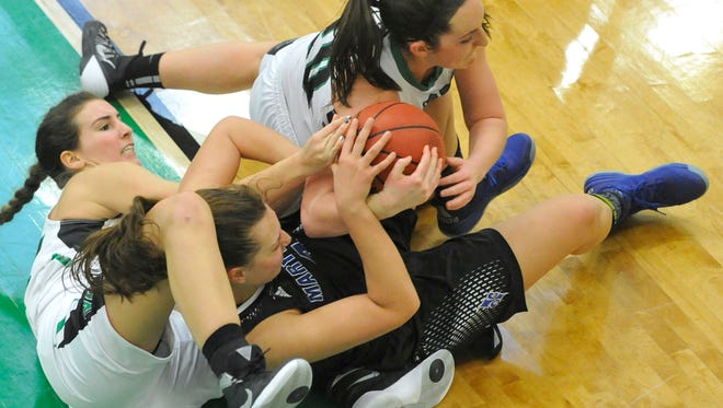 Marymount's Nicole Viscuso, center, battles for a loose ball with York College's Sam Hruz, left ,and Beth Wiseley during the Spartans' 61-33 loss on Saturday.
