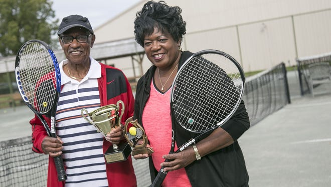 Hatcher Day and lady friend Ivy Amos with some of their tennis hardware. Day, 81, recently won a national title in 80-and-over doubles and Amos, one of his playing partners at Lakewood Racquet Club, took second in mixed doubles, with her brother, Ed, at the Tri-City Tournament in Detroit.