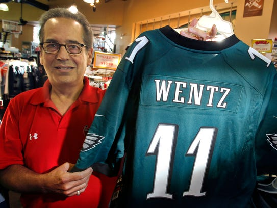 Bob Hart of Al's Sporting Goods displays Carson Wentz jerseys in stock at the Wilmington store last year.
