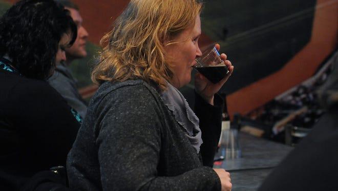 Attendees sample beers during Beer School at BB's Pub N Grill.