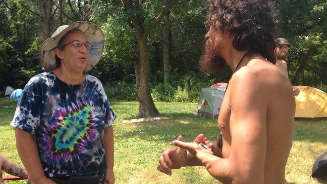 Wilmington resident Michelle Ievoli, left, speaks with another protester at FDR Park in Philadelphia on Thursday.