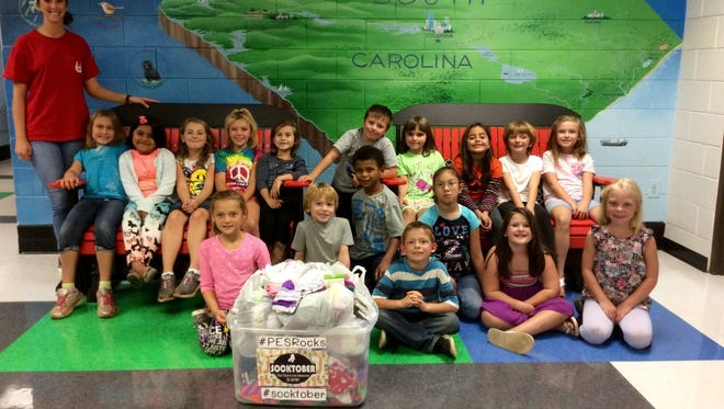 Mrs. Wigington's class does an excellent job of collecting socks to give to different centers.