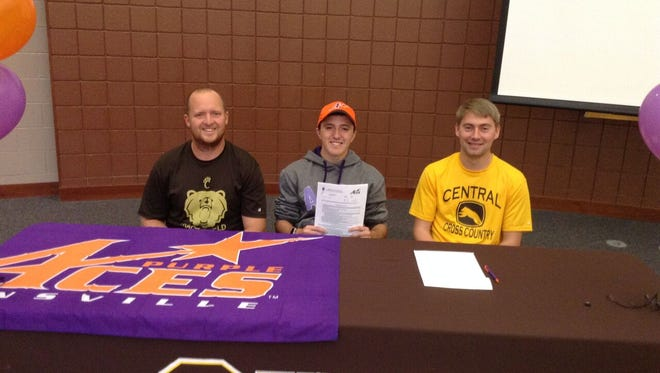 Central High School's Tyler Frields-Reifsteck (center) signed his letter of intent to run cross country and track at the University of Evansville on Thursday.