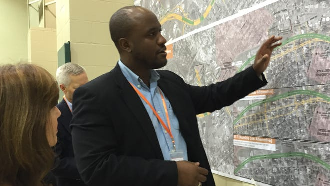 Joseph Cains, a consultant designing the I-49 Lafayette Connector explains details of the proposal to a resident Oct. 19, 2017.