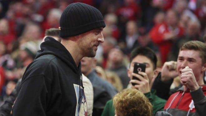 Packers quarterback Aaron Rodgers  was in attendance and celebrated the Badgers' victory over the Hoosiers on Tuesday night.