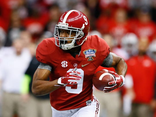 Alabama receiver Amari Cooper is the first of six projected to go in the first round of our mock draft.