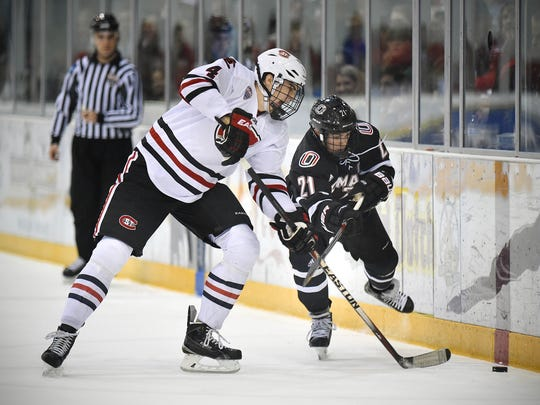 St. Cloud State's Ben Storm (left) and Nebraska-Omaha's