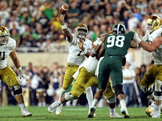 Notre Dame Fighting Irish quarterback Brandon Wimbush (7) attempts to throw the ball during the first half a game against the Michigan State Spartans at Spartan Stadium.