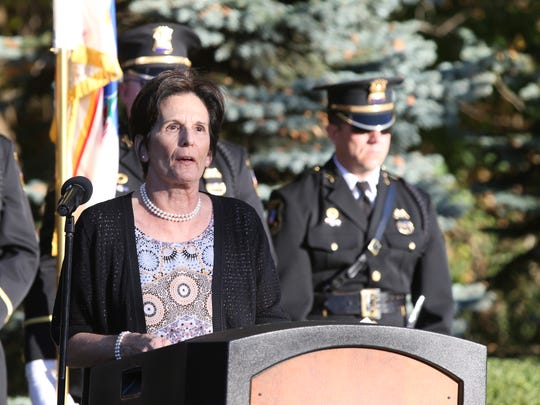 Diane O'Grady, wife of Nyack Police Sergeant Edward O'Grady, offers remarks during the 36th memorial for Brinks robbery in Nyack on Friday, October 20, 2017.