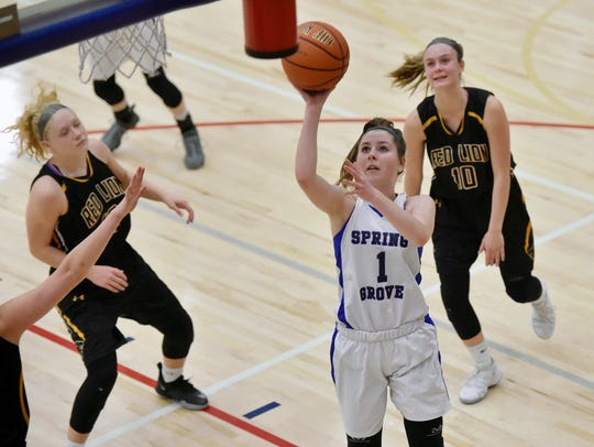 Spring Grove's Ellie Glass shoots against Red Lion during a game last season. Glass is averaging 10.3 points this season, but contributes in a variety of ways.