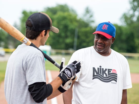 Tony Moncrief, right, works with Luke Borkovich at a hitting class Tuesday, June 19, 2018, at the little league park in Fort Gratiot. Moncrief, a former professional baseball player and Port Huron Northern graduate, runs his own hitting classes.