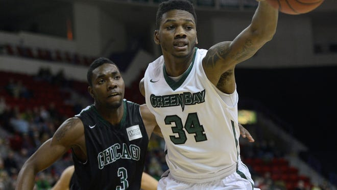 UW-Green Bay forward Alfonzo McKinnie chases after a ball while trailed by Chicago State sophomore Johnny Griffin in the first half at the Resch Center on Wednesday, Dec. 31, 2014.