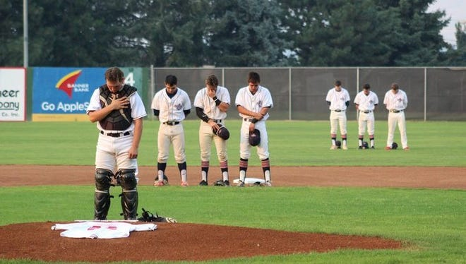 The Wenatchee AppleSox hold a moment of silence in honor of Tommy Watanabe, who suddenly died during his sleep last Saturday.