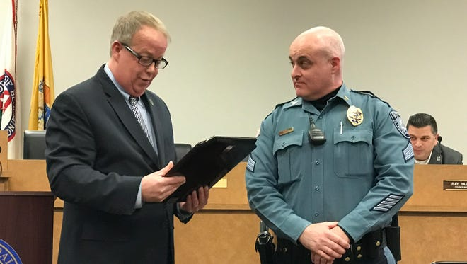 Bloomingdale Police Sgt. Daniel Fletcher received a merit award from Mayor Jonathan Dunleavy for talking a man out of committing suicide.