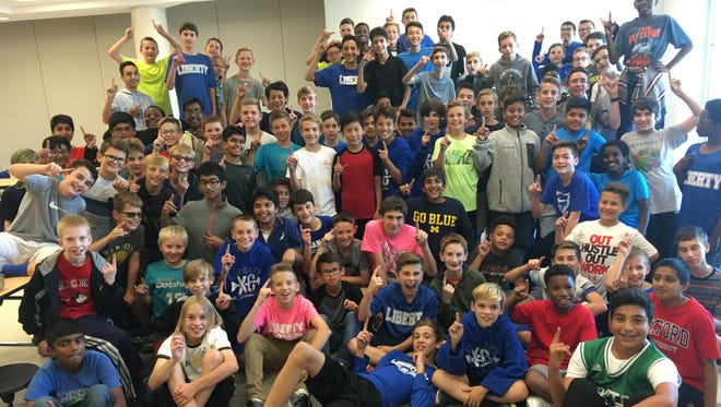 Liberty Middle School cross country runners celebrate after the Oct. 17 league meet.