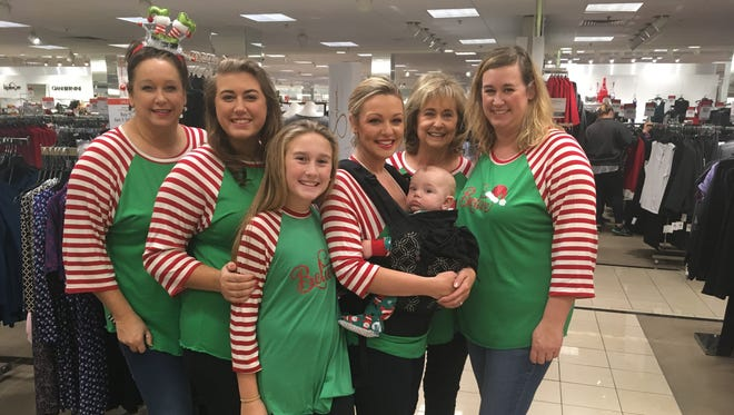 Kelly Mitchell, Emily Roberts, Ava Roberts, Lauren Cotthoff (with baby Henry), Linda Burnam and Kristen Roberts continue their annual Black Friday shopping tradition.