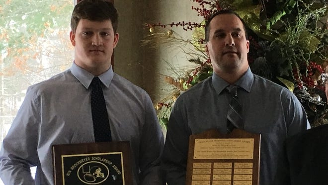 D.C. Everest's Zach Mueller, left, and Evergreens coach Tim Strehlow pose for photos after Mueller was named the recipient of the Win Brockmeyer Memorial Award Friday morning at the Wausau Country Club.