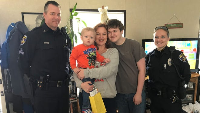 Sgt. Todd Seipenko and Officer Caitlin King brought gifts to mom Melissa, grandson Weston and son Lance, among others.