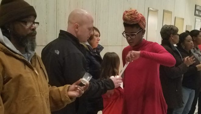"""Marion community members gathered Monday to celebrate the life and work of Martin Luther King Jr. As part of """"Never Lose Hope: Unity Wins,"""" citizens marched to Marion City Hall and had a candlelight service."""