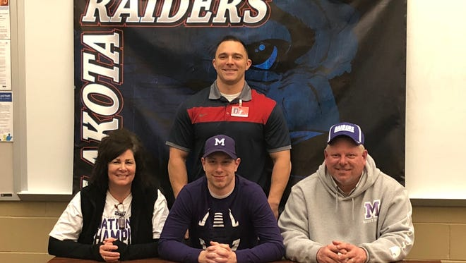 Lakota's Lucas Streacker continues his football career at Mount Union. He's joined at his announcement by Lakota coach Mike Lento, Deb Streacker and Jeff Streacker.