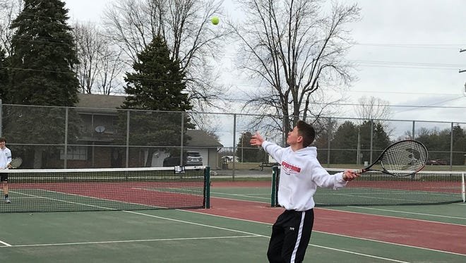 Pleasant's Dan Williams serves against Buckeye Valley in a Mid Ohio Athletic Conference match last week at Pleasant.