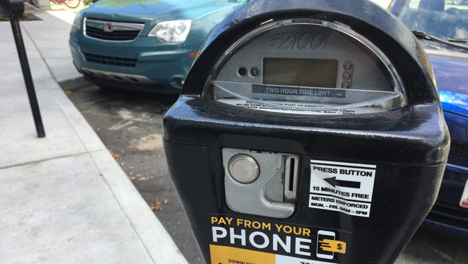 Covington's parking meter rate of $1.10 per hour and rates for three city garages will be under the review of a new city parking authority.