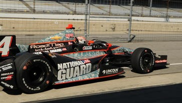 Ryan Briscoe  leave the pit  box while testing Indy Cars on the road course Wednesday, Sept 4, 2013 at The Indianapolis Motor Speedway  .  Greg Griffo / The Star