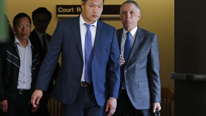 "FILE – In this May 15, 2017, file photo, Raymond Lam, center, leaves the Monroe County Courthouse in Stroudsburg, Pa. Lam is one of four men from the New York City borough of Queens who pleaded guilty to involuntary manslaughter in the 2013 death of Chun ""Michael"" Deng, a fraternity pledge from the Baruch College campus of the City University of New York, at a rented house in the Pocono Mountains. The four are set to be sentenced Monday, Jan. 8, 2018, along with the Pi Delta Psi fraternity itself, which was convicted after a trial. (AP Photo/Rich Schultz, File)"