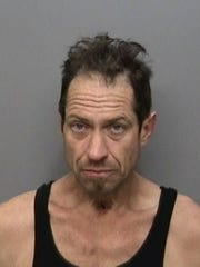 Michael Robert McPherson Date of Birth: Sept. 3, 1971 Vitals: 6 feet, 3 inches; 180 pounds; brown hair, blue eyes Charge: Violation of probation