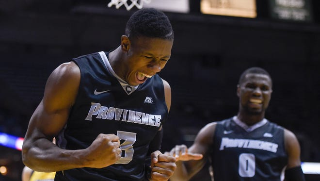 Providence Friars guard Kris Dunn (3) reacts after drawing a foul in the second half during the game against the Marquette Golden Eagles.