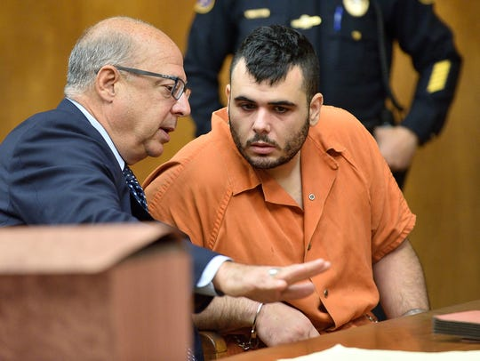 Jesus Lopez, right, pictured on Nov. 3, 2017, speaks with his attorney John Bruno before he is arraigned in Bergen County Superior Court on charges of murdering his mother after which he hid her body.