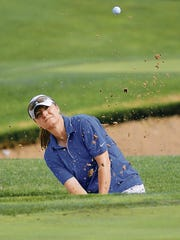 MARK LAMBIE—EL PASO TIMES  Jennifer Delgadillo hits a bunker shot on the ninth hole Thursday during the opening round of the Sun City Women's Golf Championship at Coronado Country Club.