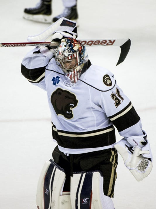 Hershey goaltender Philipp Grubauer skates off the ice after losing in overtime to the Hartford Wolf Pack in Game 1 of the Eastern Conference semifinals at the Giant Center on Wednesday.
