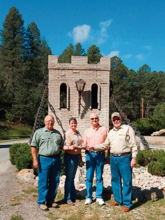 From left — Village of Ruidoso Forester Dick Cooke, Lynn Lovelace, District Forester for New Mexico State Forestry and Pete Allen and Leroy Cockrell from the Black Forest Firewise Committee with plaque.