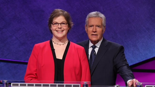 "Green Bay Preble High School choral director Sara Holub and ""Jeopardy!"" host Alex Trebek"