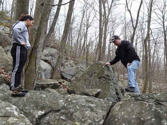 From left, Cassidy and Jim Janso prepare to enter a cave in the Town of Philipstown on March 23. Janso believes this cave was used by a counterfeiter in the early nineteenth century.