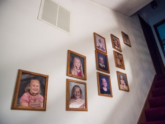 Portraits of Briana hang on the walls throughout Rich