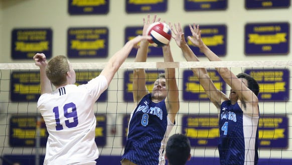 Suffern's Dan Kenny (8) and Will Krebs (4) leaps for
