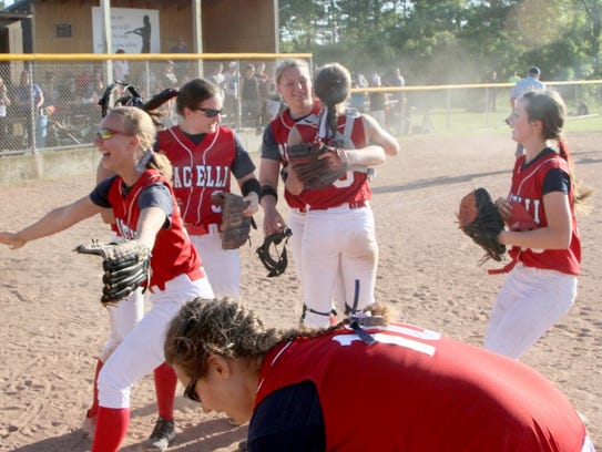 Pacelli players celebrate after knocking off Cochrane-Fountain